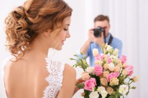 photographer taking a photo of a bride on her wedding day